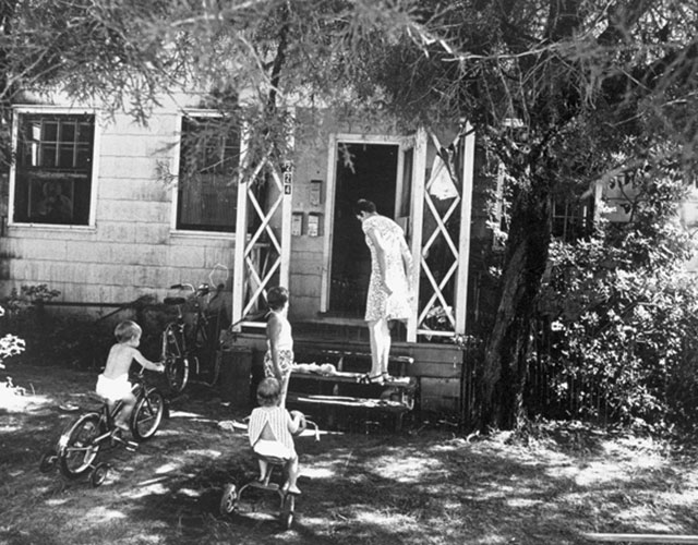 A-woman-and-3-children-outside-one-of-the-Flavet-apartments-on-the-University-of-Florida-campus