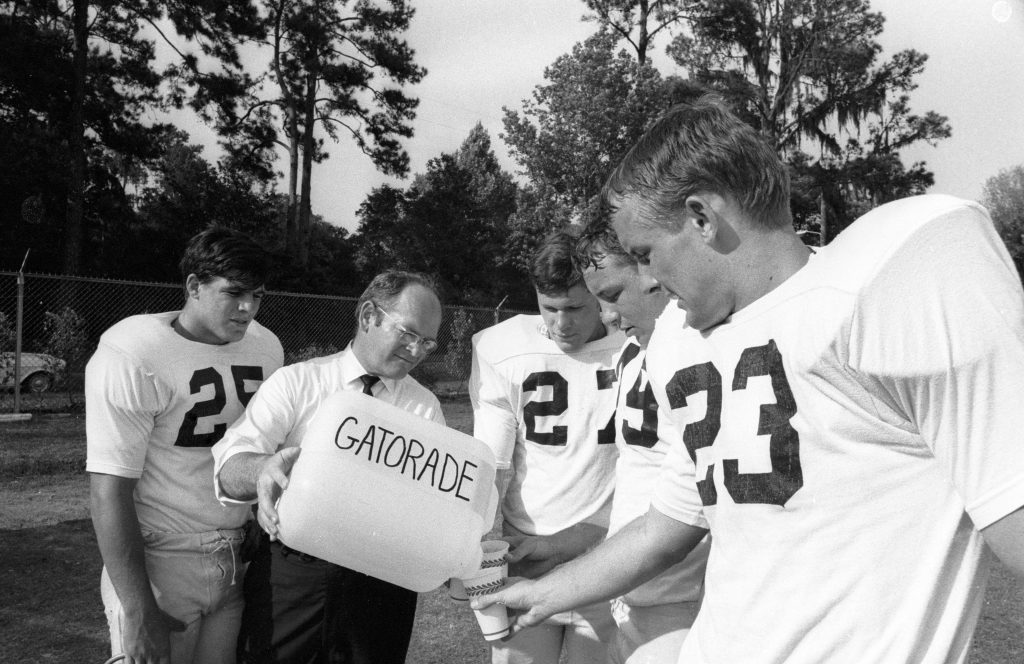 Nutritional Supplements: University of Florida College of Medicine Dr. Robert Cade, creator of Gatorade, serving Gatorade to football players during practice. Gainesville, FL 4/27/1968 CREDIT: Lynn Pelham (Photo by Lynn Pelham /Sports Illustrated/Getty Images) (Set Number: X13176 TK1 R6 F24 )