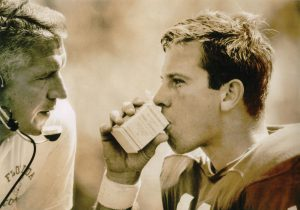 Heisman Trophy winner and longtime Gator coach Steve Spurrier drinks Gatorade from a milk carton on the sidelines during a game in 1966.