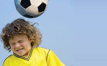 kid hit soccer ball with head