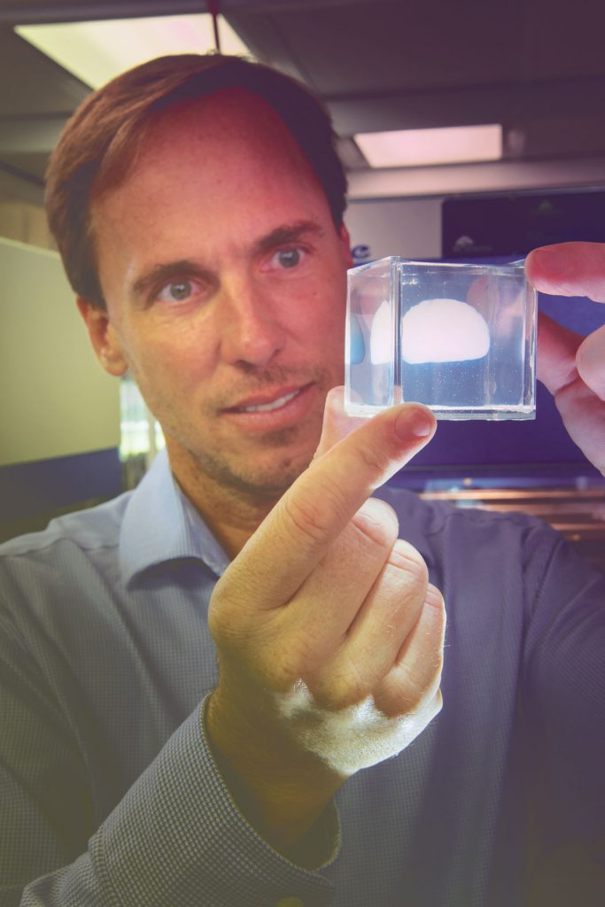Greg Sawyer examines a small-scale, soft matter model of a brain.
