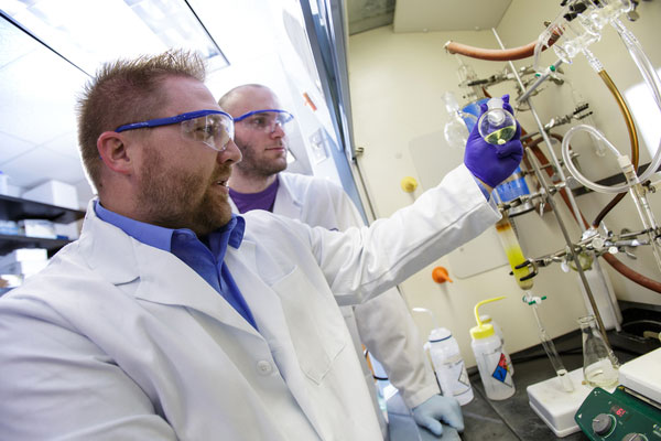 Dr. Rob Huigens, left, leads a team of UF researchers that developed potent new compounds that can kill dangerous bacterial biofilms present in recurring and chronic bacterial infections