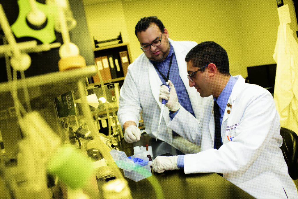 University of Florida Assistant Professor of Emergency Medicine Faheem Guirgis and Scientific Research Manager Ricardo Ungaro work with samples in the UF Sepsis and Critical Illness Research Center