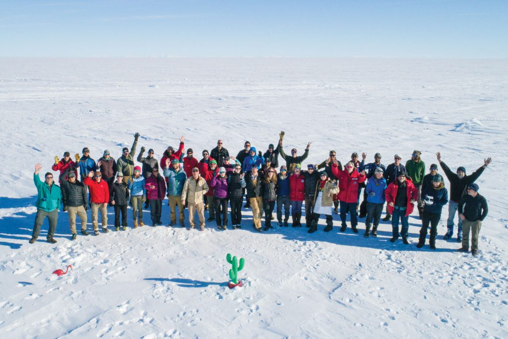 Aerial group picture of the team in Antarctica