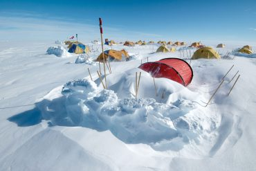 Tents semi-buried in snow in Antarctica