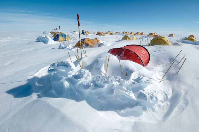 Tents semi-burried in snow in Antarctica