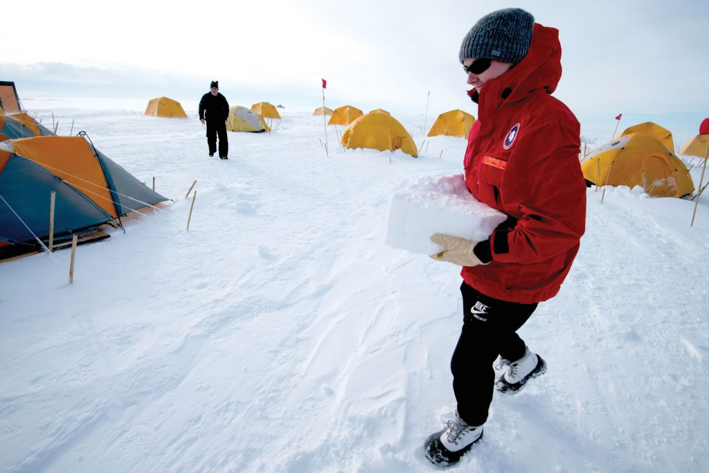 Christina Davis carrying an ice block