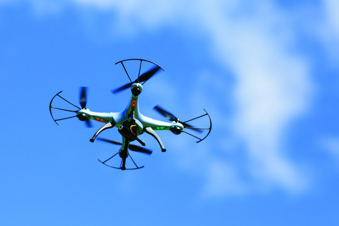 Drone flying in the sky, robot farms