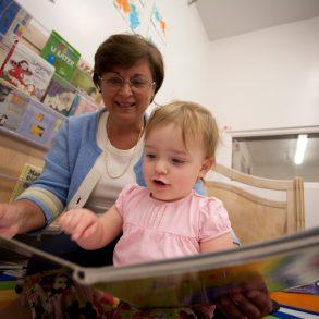 Teacher reading with child