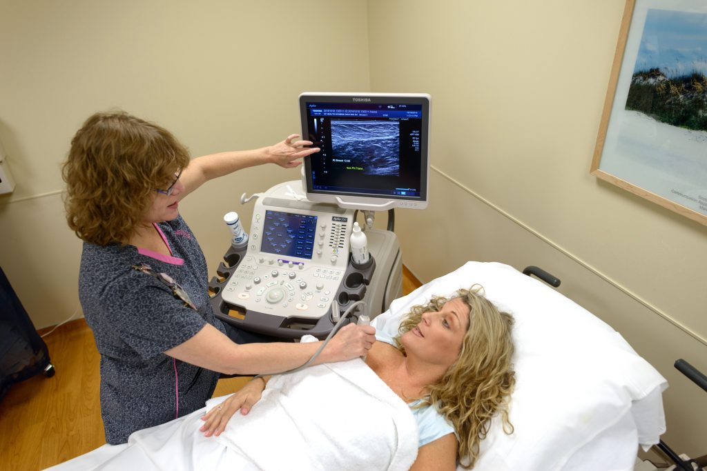 Nurse treating breast cancer patient