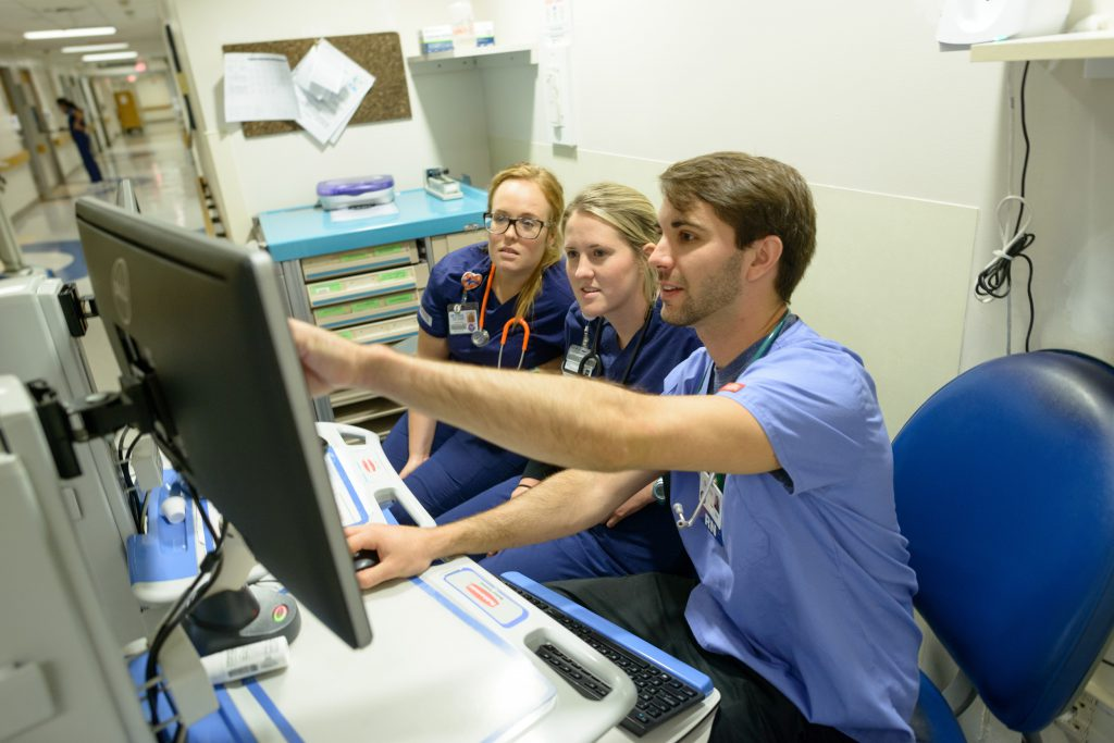 Nurses viewing monitor