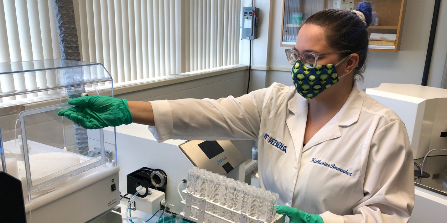 Katherine Bermudez conducts research in lab wearing PPE.