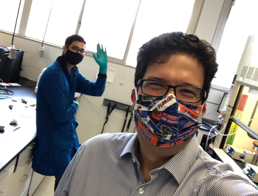 Selfie of Carlos Rinaldi in lab wearing mask.