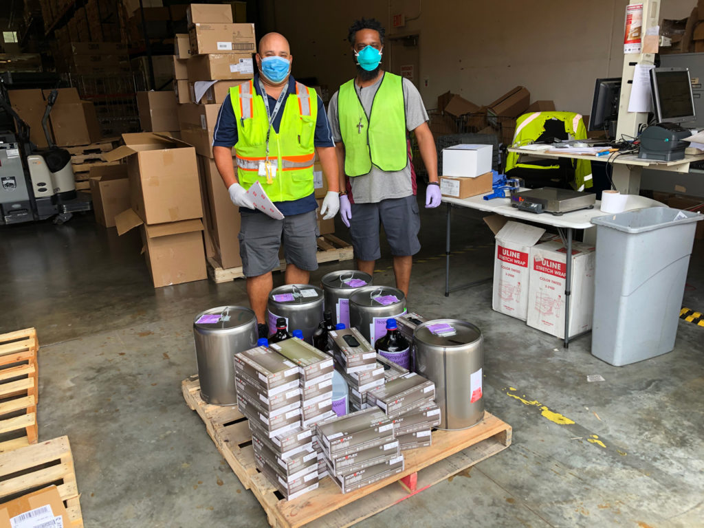UF Health warehouse workers wearing PPE.