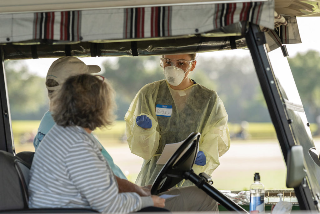 UF Health volunteer administers COVID-19 tests to residents of The Villages.