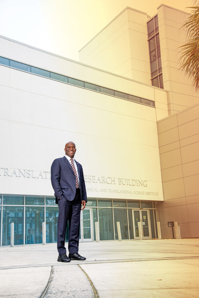 Portrait of Duane Mitchell standing outside the Clinical and Translational Research Building